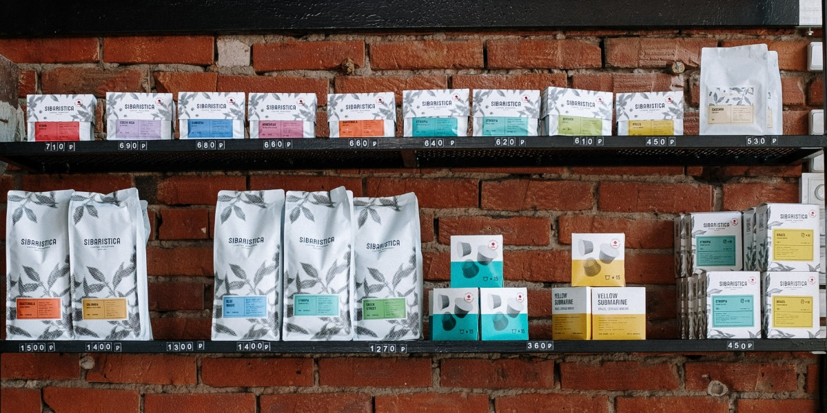 Printed, colorful coffee bags in a coffee shop.