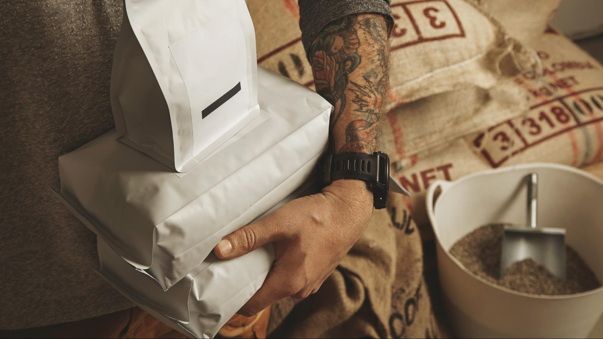 How can specialty coffee roasters reduce their delivery costs?