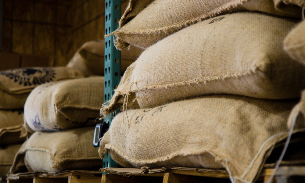 How does coffee price volatility affect roasters?